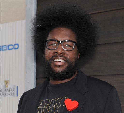 "In this June 8, 2013 file photo, Questlove arrives at Spike TV's Guys Choice Awards at Sony Pictures Studios in Culver City, Calif. The Roots leader is executive producing a music series for VH1 that will feature three artists performing simultaneously on one stage. ""SoundClash"" debuts July 23, 2014, with Lil Wayne, Fall Out Boy and buzzed British group London Grammar. (Photo by Frank Micelotta/Invision/AP, File)"