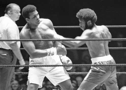 In this July 27, 1971, file photo, Referee Jay Edson, left, keeps an eye on the fight between Muhammad Ali and Jimmy Ellis, right, in the 12th round of their heavyweight fight in Houston. Ellis, a former heavyweight boxing champion who trained with fellow Louisville fighter Muhammad Ali and squared off against some of his era's best fighters, has died in his hometown Tuesday, May 6, 2014. He was 74. Ellis' brother, Jerry, said the ex-champion died at a Louisville hospital Tuesday after suffering from Alzheimer's disease in recent years. (AP Photo/File)