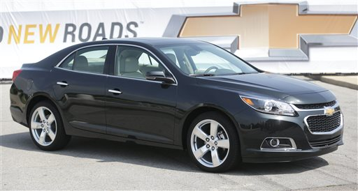 In this May 31, 2013 file photo, the 2014 Chevrolet Malibu is unveiled on Belle Isle in Detroit. General Motors is recalling more than 140,000 2014 Chevrolet Malibu midsize cars to fix a problem with the power-assisted brakes. The recall affects models with 2.5-liter four-cylinder engines and stop-start technology that shuts off the engine at red lights. (AP Photo/Carlos Osorio, File)