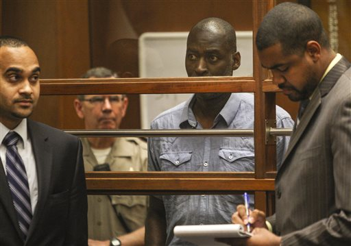 """Actor Michael Jace appears in court in Los Angeles Thursday, May. 22, 2014.  A judge has delayed the arraignment of  Jace on a murder charge filed over his wife's shooting death earlier this week. Attorneys for Jace, who played a police officer in the hit TV series """"The Shield,"""" sought a continuance during the actor's first court appearance in Los Angeles on Thursday. He's due back in court June 18. The 51-year-old was charged Thursday with a single count of murder and he is accused of shooting his wife April multiple times in their home Monday evening. (AP Photo/David McNew, Pool)"""