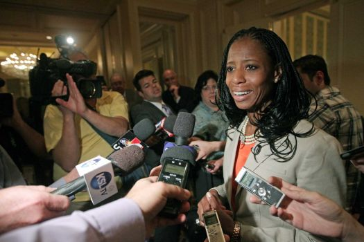Republican Mia Love candidate for Utah's 4th Congressional District responds to questions from the media following the annual conference of the Utah Taxpayers Association Tuesday, May 20, 2014, in Salt Lake City. In their first appearance together, Republican Love and Democrat Doug Owens fielded questions from a Utah taxpayer watchdog group. (Rick Bowmer/AP Photo)