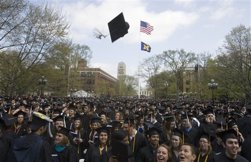 In this  Saturday, April 26, 2008, file photo, University of Michigan graduates celebrate after their spring commencement ceremony, in Ann Arbor, Mich. (AP Photo/Tony Ding, File)