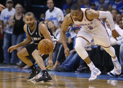 San Antonio Spurs guard Tony Parker, left, and Oklahoma City Thunder guard Russell Westbrook (0) watch a loose ball in the second quarter of Game 4 of the Western Conference finals NBA basketball playoff series in Oklahoma City, Tuesday, May 27, 2014. (AP Photo/Sue Ogrocki)