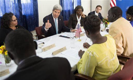US Secretary of State John Kerry, center, meets with civil society leaders at the US embassy in Juba, South Sudan, Friday May 2, 2014. Kerry, landing in the capital Juba on Friday, carried the threat of U.S. sanctions against prominent South Sudanese leaders if the rampant violence doesn't stop. But more than anything, he sought to compel authorities on both sides of the fight to put aside personal and tribal animosities for the good of a nation that declared independence three years ago to escape decades of war. (AP Photo/Saul Loeb, Pool)