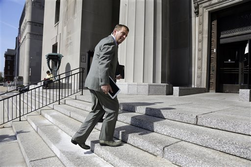 Former Anheuser-Busch CEO August Busch IV enters the Civil Court building before testifying in a gender discrimination lawsuit Tuesday, May 6, 2014, in St. Louis. Francine Katz, former vice president of communications and consumer affairs for the maker of Budweiser, Bud Light and other beers, is suing Anheuser-Busch for gender discrimination. (AP Photo/Jeff Roberson)