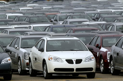 This March 16, 2006 file photo shows a Pontiac G6 shown outside the General Motors Orion Assembly plant in Orion Township, Mich. General Motors is recalling 2.4 million vehicles in the U.S., including Pontiac G6's from the 2005-2008 model years, as part of a broader effort to resolve outstanding safety issues more quickly.  (AP Photo/Paul Sancya, File)