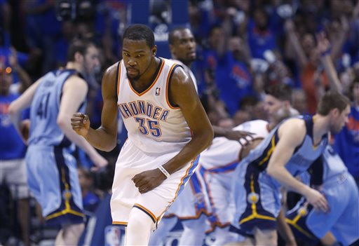 Oklahoma City Thunder forward Kevin Durant (35) pumps his fist as he heads back up the court following a three-pointer in the second quarter of Game 7 of an opening-round NBA basketball playoff series against the Memphis Grizzlies in Oklahoma City, Saturday, May 3, 2014. (AP Photo/Sue Ogrocki)