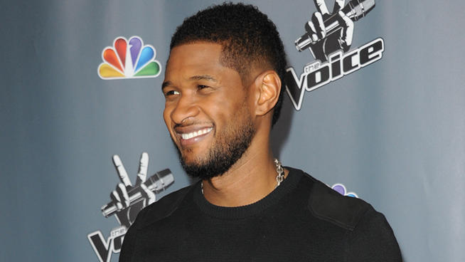 "Usher arrives at the 4th season premiere screening of ""The Voice"" at the TCL Theatre on Wednesday, March 20, 2013 in Los Angeles. (Richard Shotwell/Invision/AP)"