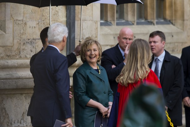 Hillary Rodham Clinton, center, laughs with her husband, former U.S. President Bill Clinton, at their daughter Chelsea's Oxford University graduation ceremony on Saturday. (Matt Dunham/AP)