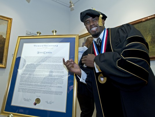 Sean Combs standing next to his honorary degree from Howard University on May 10, 2014 (Jose Luis Magana/ Associated Press)