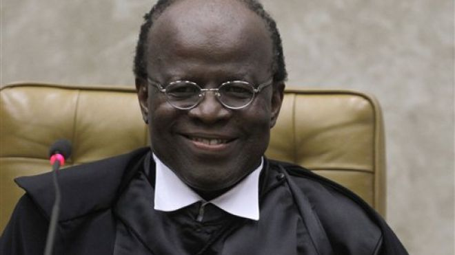 Joaquim Barbosa smiles during his inauguration ceremony at the Supreme Court in Brasilia, Brazil. (AP Photo)