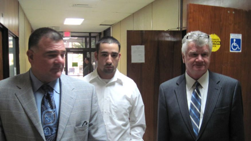 Oct. 22, 2010: Former Winnfield Police Officer Scott Nugent, center, walks with his attorneys Phillip Terrell, left and George Higgins in the Winn Parish Courthouse in Winnfield, La. (AP Photo)