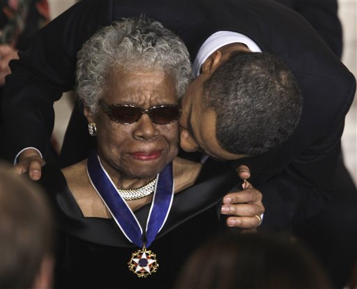 "In this Feb. 15, 2011 file photo, President Barack Obama kisses author and poet Maya Angelou after awarding her the 2010 Medal of Freedom during a ceremony in the East Room of the White House in Washington. Angelou, author of ""I Know Why the Caged Bird Sings,"" has died, Wake Forest University said Wednesday, May 28, 2014.  She was 86. (AP Photo/Charles Dharapak, File)"