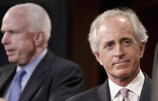 """Sen. Bob Corker, R-Tenn., right, accompanied by Sen. John McCain, R-Ariz., listens during a news conference on Capitol Hill in Washington, Wednesday, April 30, 2014. Corker was the only Republican to cross party lines and vote """"yes"""" in favor of allowing debate on the Minimum Wage Fairness Act to proceed.  The measure was stopped in the Senate,  handing a defeat to President Barack Obama on a vote that is sure to reverberate in this year's congressional contests. (AP Photo)"""