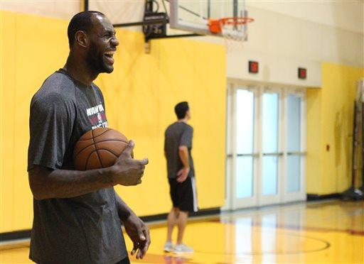 Miami Heat forward LeBron James laughs during practice Thursday, May 29, 2014, in Miami. The Heat lead the Indiana Pacers 3-2 in the NBA basketball Eastern Conference finals, with the next game scheduled for Friday. (AP Photo/El Nuevo Herald, David Santiago)