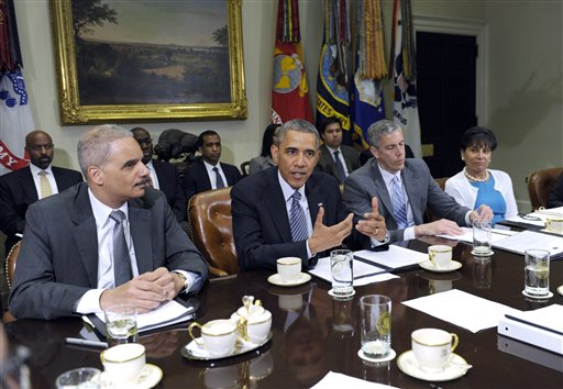 """President Barack Obama, flanked by Attorney Holder Eric Holder, left, and Housing and Urban Development Secretary Shaun Donovan, left, speaks about a report from """"My Brother's Keeper,"""" an initiative to expand opportunity for young men and boys of color, Friday, May 30, 2014, during a meeting in the Roosevelt Room of the White House in Washington. (AP Photo/Susan Walsh)"""