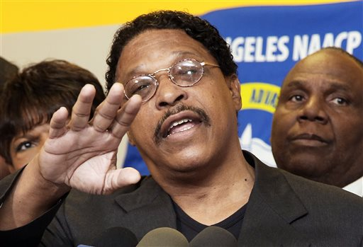 In this April 28, 2014 file photo, Leon Jenkins, president of the Los Angeles chapter of the NAACP, announces that Los Angeles Clippers basketball team owner Donald Sterling will not be receiving his lifetime achievement award, at a news conference in Culver City, Calif. Jenkins resigned Thursday, May 1, 2014 following outrage over a decision he later reversed to give Los Angeles Clippers owner Donald Sterling an award for promoting civil rights.  (AP Photo/Nick Ut, File)