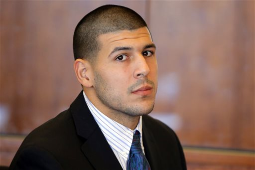 In this Oct. 9, 2013 file photo, former New England Patriots NFL football player Aaron Hernandez attends a pretrial court hearing in Fall River, Mass. Hernandez is due in court Wednesday, May 28, 2014 to be arraigned on murder charges for allegedly ambushing and gunning down two men in 2012 after a chance encounter inside a Boston nightclub. (AP Photo/Brian Snyder, Pool, File)