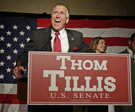 In this May 6, 2014, photo Thom Tillis speaks to supporters at a election night rally in Charlotte, N.C., after winning the Republican nomination for the U.S. Senate Tuesday, May 6, 2014. Tillis' victory in the North Carolina Senate primary has spurred both sides to immediately draw battle lines that could frame Senate races across the nation. After dispatching several tea party and Christian-right rivals on Tuesday, Tillis quickly cast Democratic Sen. Kay Hagan as an Obama acolyte. Hagan countered quickly, painting the North Carolina House speaker as the face of Republican extremism. (AP Photo/Chuck Burton)