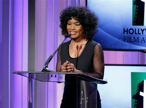 FILE - In this Oct. 21, 2013 file photo, actress Angela Bassett speaks on stage at the 17th Annual Hollywood Film Awards Gala at the Beverly Hilton Hotel in Beverly Hills, Calif. The Lifetime TV channel says it will air a movie about the relationship of Whitney Houston and Bobby Brown, with Bassett set to direct. The channel said Thursday, May 22, 2014, the movie will follow the couple through their first meeting and tumultuous marriage and Houston's rise to fame. (Photo by Todd Williamson/Invision/AP)
