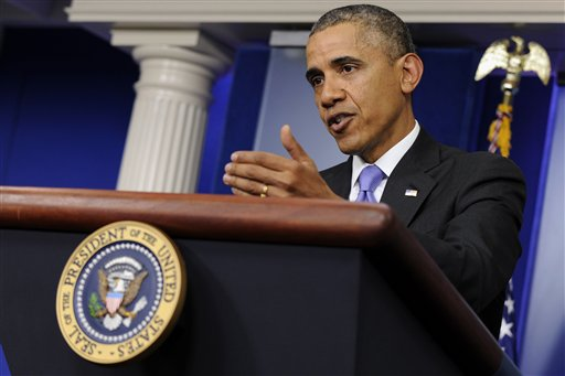 In this May 21, 2014, photo, President Barack Obama speaks in the Brady Press Briefing Room of the White House in Washington, following his meeting with Veterans Affairs Secretary Eric Shinseki. After weeks of criticism for his detached response, Obama showed new resolve this week on the growing crisis over veterans' health care. He called Shinseki to a White House meeting and then repeatedly vowed to take action at a news conference. The growing furor over veterans' health care moved to campaign trail Thursday as congressional candidates from both parties called for Shinseki to be fired.  (AP Photo/Susan Walsh)