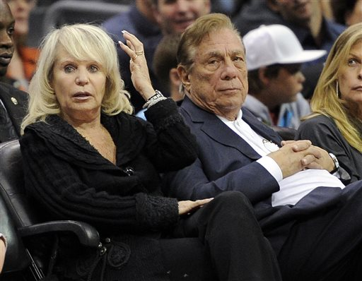 In this Nov. 12, 2010, file photo, Los Angeles Clippers owner Donald T. Sterling, right, sits with his wife Rochelle during the Clippers NBA basketball game against the Detroit Pistons in Los Angeles. An attorney representing the estranged wife of Clippers owner Donald Sterling said Thursday, May 8, 2014, that she will fight to retain her 50 percent ownership stake in the team.  (AP Photo/Mark J. Terrill, File)