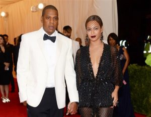 "This May 5, 2014 file photo shows Jay Z, left, and Beyonce at The Metropolitan Museum of Art's Costume Institute benefit gala celebrating ""Charles James: Beyond Fashion"" in New York. Beyonce, Jay Z and Solange say they have worked through and are moving on since a video leaked this week of Solange attacking Jay Z in an elevator inside the Standard Hotel after the May 5, gala. (Photo by Evan Agostini/Invision/AP, File)"