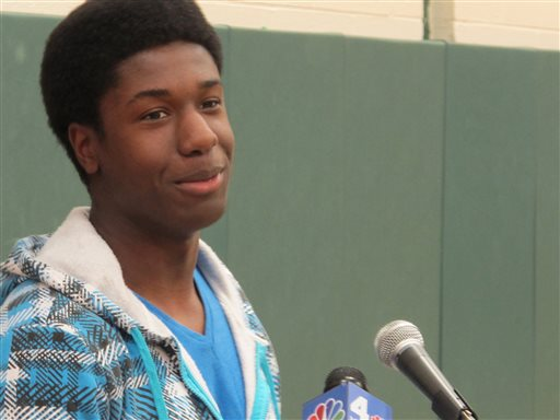 Kwasi Enin speaks at a news conference at William Floyd High School in Mastic Beach, N.Y., on Wednesday, April 30, 2014. Enin, who was accepted into all eight Ivy League colleges, announced he will attend Yale University in the fall. Enin says he wants to study medicine. His parents are both nurses and immigrated to the United States from Ghana in the 1980s. (AP Photo/Frank Eltman)