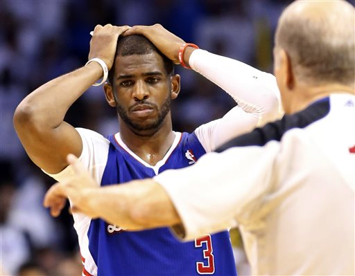 Los Angeles Clippers guard Chris Paul reacts after being called for a foul on Oklahoma City Thunder guard Russell Westbrook in the final seconds of the fourth quarter of Game 5 of the Western Conference semifinal NBA basketball playoff series in Oklahoma City, Tuesday, May 13, 2014. Oklahoma City won 105-104. (AP Photo)