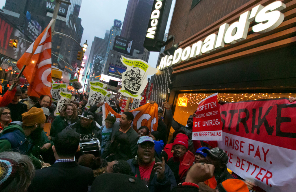 Demonstrators rally for better wages outside a McDonald's restaurant in New York, as part of a national protest, Thursday, Dec. 5, 2013. (AP Photo/Richard Drew)