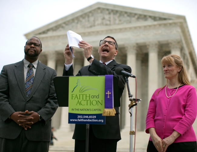 Reverend Dr. Rob Schenck, of Faith and Action, center, speaks in front of the Supreme Court with Raymond Moore, left, and Patty Bills, both also of Faith and Action, during a news conference, Monday, May 5, 2014, in Washington, D.C. (Carolyn Kaster/AP)
