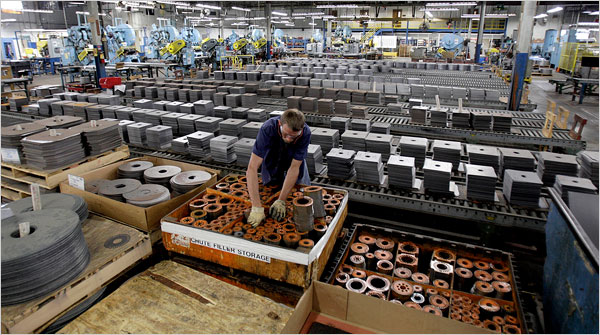 An employee on duty at the Baldor Electric Co. factory in St. Louis in June. The government reading on U.S. gross domestic product released Friday was better than economists expected. (Jeff Roberson/Associated Press)