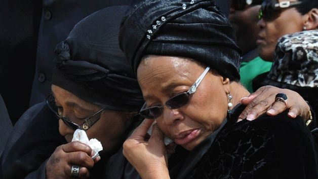 Mandela's widow, Graça Machel (right) and Winnie Madikizela-Mandela embrace at Nelson Mandela's funeral. (Kopano Tlape, CGIS/AP Photo)