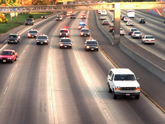 With Al Cowlings driving and O.J. Simpson in the backseat, the infamous Ford Bronco makes it way down the highway on June 17, 2014. (Joseph Villarin/AP)