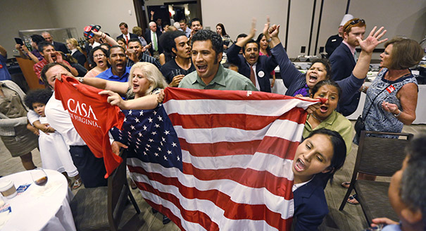 Immigration reform supporters crash the primary-night party of House Majority Leader Eric Cantor, R-Va., after he delivered a concession speech in Richmond, Va. on Tuesday, June 10, 2014. (AP Photo/Steve Helber)