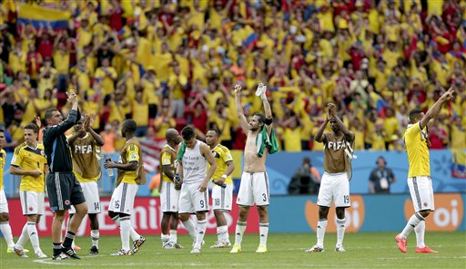 Colombian players celebrate after the group C World Cup soccer match between Colombia and Ivory Coast at the Estadio Nacional in Brasilia, Brazil, Thursday, June 19, 2014.  Colombia won the match 2-1.  (AP Photo/Marcio Jose Sanchez)