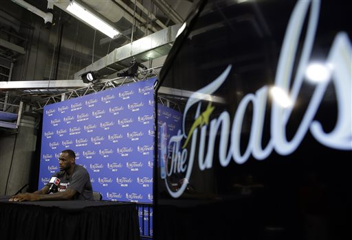Miami Heat's LeBron James responds to a question during an NBA basketball media availability at the NBA Finals, Wednesday, June 11, 2014, in Miami. The San Antonio Spurs lead the Heat 2-1 in the best-of-seven games series. (AP Photo/Lynne Sladky)