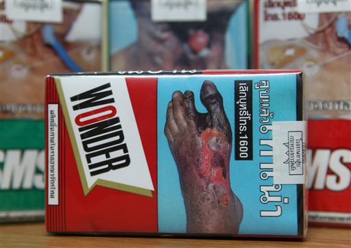 Warning signs on cigarette packets in Bangkok. (AP Photo/Apichart Weerawong, File)