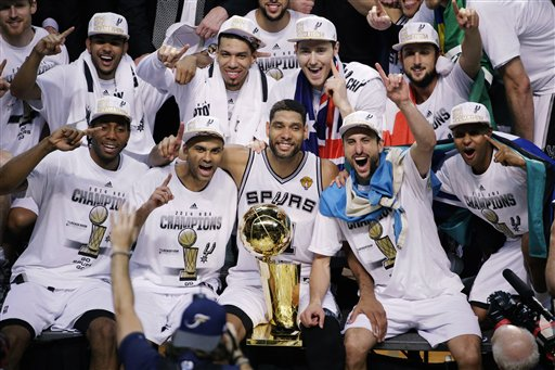 The San Antonio Spurs pose for a photo after Game 5 of the NBA basketball finals against the Miami Heat on Sunday, June 15, 2014, in San Antonio. The Spurs won the NBA championship 104-87. (AP Photo/Tony Gutierrez)