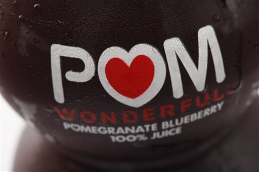 """This Sept. 27, 2010 file photo shows a bottle of POM Wonderful juice in Philadelphia. The Supreme Court on Thursday sided with juice maker Pom Wonderful in its long-running false advertising dispute with Coca Cola, a decision that could open the door to more litigation against food makers for deceptive labeling. The justices ruled 8-0 that Pom can go forward with a lawsuit alleging the label on a """"Pomegranate Blueberry"""" beverage offered by Coke's Minute Maid unit is misleading because 99 percent of the drink consists of apple and grape juice. (AP Photo/Matt Rourke, File)"""