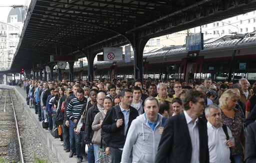 Commuters arrive at the Gare de l'Est train station by one of a few trains available today in Paris Tuesday, June 17, 2014 as French rail workers are on strike to protest a reorganization of the national rail and train companies. Seven days into a nationwide train strike that has tangled traffic and stranded tourists, the leftist government is braking a long-held French taboo and is openly criticizing the striking unions. (AP Photo/Michel Euler)