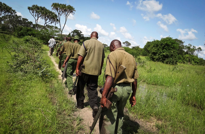 Kenyan security officers searched Tuesday for those who killed dozens in coastal communities. (Associated Press)