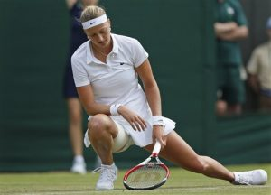 Petra Kvitova of the Czech Republic looks down after winning a point to Mona Barthel of Germany during their women's singles match at the All England Lawn Tennis Championships in Wimbledon, London, Wednesday, June 25, 2014. (AP Photo/Sang Tan)