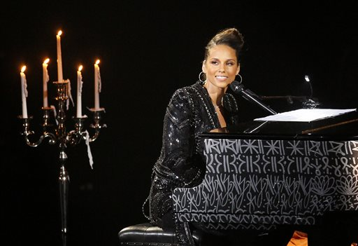 In this June 11, 2011 file photo, U.S. singer Alicia Keys plays piano as she performs during a concert at Hall of Congress in Paris. Dozens of actors and athletes are joining a U.S. government effort to support girls' education worldwide. Jennifer Garner, Keys, Anne Hathaway, DeAndre Jordan, Tyler Perry and Kelly Osborne are among the stars explaining the importance of education for girls around the globe in a video premiering Friday, June 20, 2014, for the new Let Girls Learn initiative.  (AP Photo/Francois Mori, file)