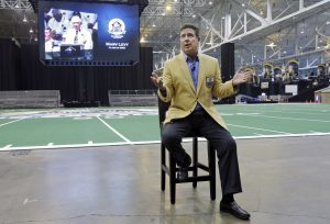 Miami Dolphins' Hall of Fame quarterback Dan Marino speaks at a news conference promoting the Pro Football Hall of Fame fanfest at the I-X Center in Cleveland Tuesday, April 29, 2014. The inaugural event  will allow fans to meet and interact with 100 members of the Pro Football Hall of Fame May 3-4, 2014. (AP Photo)