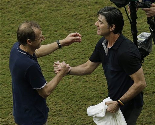 United States' head coach Jurgen Klinsmann, left and Germany's head coach Joachim Loew greet each other after the group G World Cup soccer match between the USA and Germany at the Arena Pernambuco in Recife, Brazil, Thursday, June 26, 2014. Germany beat the United States 1-0. (AP Photo/Hassan Ammar)