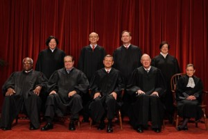 Chief Justice John Roberts is shown (front row, center) with the Associate Justices (back row) Sonia Sotomayor, Stephen Breyer, Samuel Alito Jr., (front row) Clarence Thomas, Antonin Scalia, Anthony Kennedy and Ruth Bader Ginsburg. (AP Photo/Pablo Martinez Monsivais).