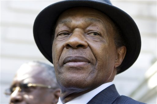 In this July 6, 2009 file photo, former District of Columbia Mayor Marion Barry attends a news conference on the steps of Washington's city hall. Barry was famously caught on videotape smoking crack cocaine in 1990 in an FBI sting. After six months in prison, he was released and won a seat on the city council. He was re-elected to a fourth term as mayor in 1994.  (AP Photo/Manuel Balce Ceneta, File)