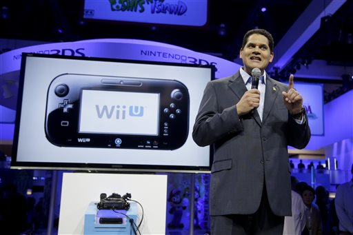 In this June 11, 2013 file photo, Reggie Fils-Aime, President and chief operating officer of Nintendo of America, addresses the media at the Nintendo Wii U software showcase during the E3 game show in Los Angeles. After the launch of Sony's PlayStation 4, Microsoft's Xbox One and Nintendo's Wii U consoles, a combination of both original creations and the latest installments in long-running series will be a major focus at this year's Electronic Entertainment Expo held June 10-12, 2014, in Los Angeles. (AP Photo/Jae C. Hong, file)