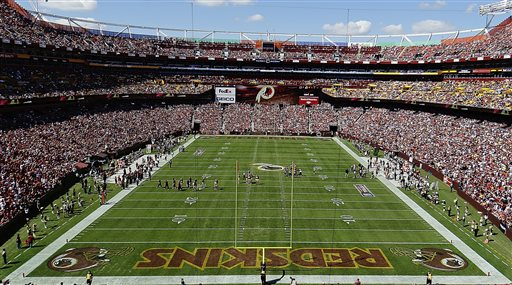 """In this Sept. 24, 2012, file photo, the Washington Redskins and Cincinnati Bengals face off during the first half of an NFL football game in Landover, Md. The U.S. Patent Office ruled Wednesday, June 18, 2014, that the Washington Redskins nickname is """"disparaging of Native Americans"""" and that the team's federal trademarks for the name must be canceled. The ruling comes after a campaign to change the name has gained momentum over the past year. (AP Photo/Alex Brandon, File)"""